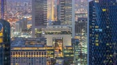 залив : Skyline view of the buildings of Sheikh Zayed Road and DIFC day to night timelapse in Dubai, UAE.