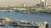retailer : Dubai creek landscape timelapse with boats and ship in port and modern buildings in the background during sunset Stock Footage