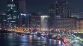 visto : Dubai creek landscape night timelapse with boats and ship near waterfront