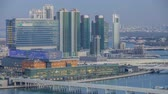 mariah : Aerial skyline of Abu Dhabi city centre from above day to night timelapse