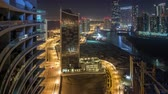 dredging : Buildings on Al Reem island in Abu Dhabi night timelapse from above.