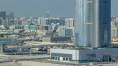 saadiyat : Buildings on Al Reem island in Abu Dhabi timelapse from above.