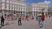 correos : People walk on the Puerta del Sol square near the fountain in Madrid, Spain Stock Footage