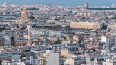 torre : Aerial panorama above houses rooftops in a Paris day to night timelapse Stock Footage