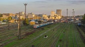 estuque : The building of the Southern Railway Station and the trains on platforms against timelapse Kharkiv, Ukraine.