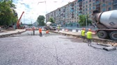 urban renewal : Concrete works for road maintenance construction with many workers and mixer timelapse