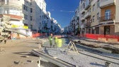 pflastersteine : Concrete works for road maintenance construction with many workers and mixer timelapse