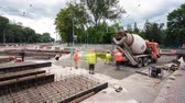 ancinho : Concrete works for road maintenance construction with many workers and mixer timelapse