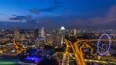 turnpike : Skyline of Singapore with famous Singapore Ferries Wheel day to night timelapse at twilight