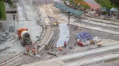 obnova : Concrete works for road maintenance construction with many workers and mixer timelapse