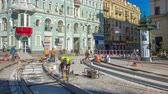 再建 : Repair works on the street timelapse. Laying of new tram rails on a city street