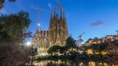 незаконченный : Sagrada Familia, a large church in Barcelona, Spain day to night timelapse. Стоковые видеозаписи
