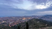 kozmopolita : Barcelona and Badalona skyline with roofs of houses and sea on the horizon day to night timelapse Stock mozgókép