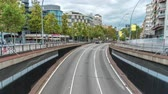 csík : Traffic passes through an underpass on the Gran Via de les Corts Catalanes as it heads towards the city centre timelapse. Barcelona, Spain Stock mozgókép