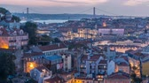 rooftop : Lisbon after sunset aerial panorama view of city centre with red roofs at Autumn day to night timelapse, Portugal