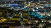 pitoresco : Lisbon aerial panorama view of city centre with illuminated building at Autumn night timelapse, Portugal