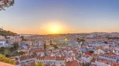 tetőtéri : Lisbon at sunset aerial panorama view of city centre with red roofs at Autumn evening timelapse, Portugal Stock mozgókép