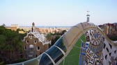 modernism : Gaudi mosaic bench and cityscape of Barcelona from park Guell, famous view of Barcelona, Spain, toned