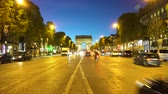 triumphal arch : PARIS, FRANCE - OCTOBER 06, 2017: car driving in front of Arc de Triomphe at night, Paris, France Stock Footage