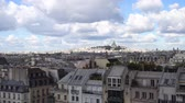 view of Paris Mont Matre hill and parisian roofs ubder blue sky with clouds, France
