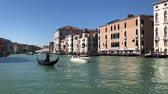 Венеция : VENICE, ITALY - MARCH 23, 2018: Gondolas floating in front of Grand Canal historical houses, old town of Venice, Italy