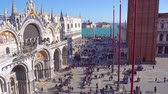 People walking in front of cathedral church and square of San Marco, Venice, Italy, timelaps Vídeos