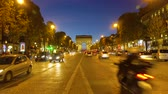 triumphal arch : PARIS, FRANCE - OCTOBER 06, 2017: cars driving in front of Arc de Triomphe at night, Paris, France