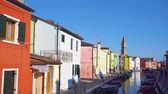 timelaps of canal with multicolored houses of Burano island, Venice, Italy