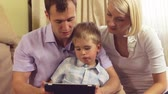 couch : Family with a tablet pc at home