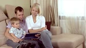 harmonie : Family with a tablet pc at home