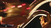 illumination : Carousels in amusement park at night Stock Footage