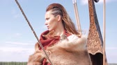 barbaric : Viking woman on the Drakkar Stock Footage