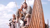 barbaric : Mad vikings on the Drakkar on the river shore