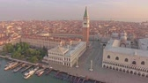 catedral : Amazing aerial view of tradiconal gondolas on Piazza San Marco and The Doges Palace embankment. Vídeos