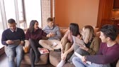 гаджет : Group of multi ethnic young students having fun to preparing for exams in home interior