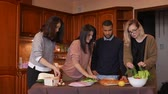 classmates : Group of multi ethnic young friends in kitchen prepare for party