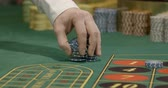 industry : Dealer mixing chips in a casino