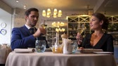 positividade : Stylish couple drinking wine in a restaurant