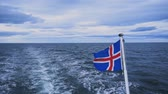 pesca : Flag of Iceland behind boat