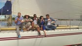 regata : Happy friends resting on a yacht