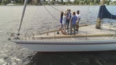 regata : Happy friends celebrating on a yacht Stock Footage