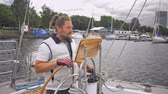 regata : Captain on a yacht behind steering wheel Stock Footage