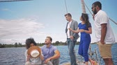 regata : Happy friends enjoying ride on a yacht Stock Footage