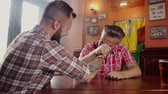 Good old friends arm wrestling in a pub Stock Footage