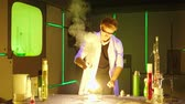 substância : Young chemist making experiments in laboratory