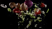 cereja : Fresh vegetables frozen in mid-air. Shooted in super slow motion