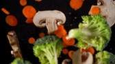 siyah : Fresh vegetables frozen in mid-air. Shooted in super slow motion