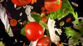 semente : Fresh vegetables frozen in mid-air. Shooted in super slow motion