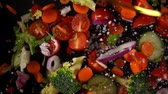 огурцы : Fresh vegetables frozen in mid-air. Shooted in super slow motion