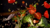 azeitonas : Fresh vegetables frozen in mid-air. Shooted in super slow motion